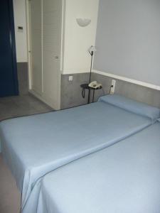 Cama o camas de una habitación en Apartamentos Descartes