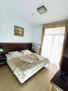 Łóżko lub łóżka w pokoju w obiekcie Diune Apart by Villmaris