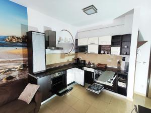 Kuchnia lub aneks kuchenny w obiekcie Diune Apart by Villmaris