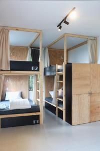 A bunk bed or bunk beds in a room at NANO ECO-HOSTEL