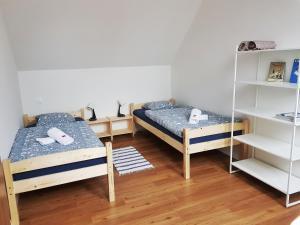 A bed or beds in a room at Ubytovanie DOBRÁ LIPA
