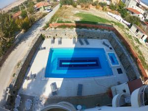 A view of the pool at Bellamaritimo Hotel or nearby