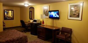 A television and/or entertainment center at Regal Inn Coffeyville