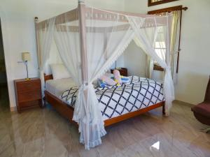 A bed or beds in a room at Villa Ida