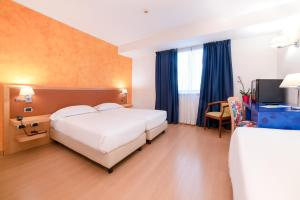 A television and/or entertainment center at ibis Styles Roma Vintage