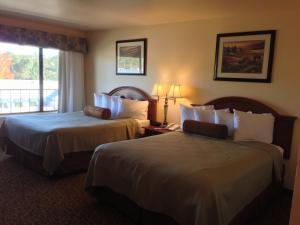 A bed or beds in a room at Best Western El Grande Inn