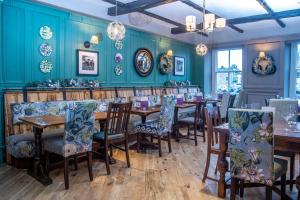A restaurant or other place to eat at Kings Head Hotel by Greene King Inns