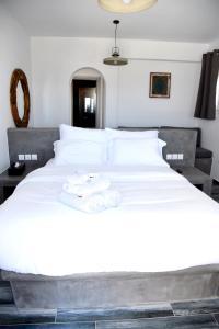 Letto o letti in una camera di Aletro Cottage Houses