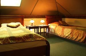 Postel nebo postele na pokoji v ubytování Pensjonat Pałacyk