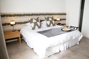 A bed or beds in a room at O2 Hotel Iguazu