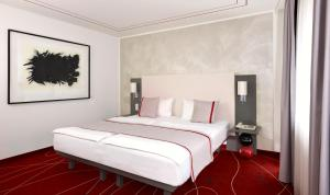 A bed or beds in a room at art'otel budapest, part of Radisson Hotel Group