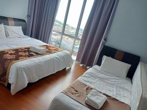 A bed or beds in a room at Sekinchan SeaView Homestay