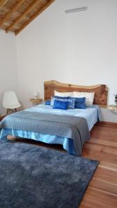 Ein Bett oder Betten in einem Zimmer der Unterkunft Basaltic Guest House Achadinha