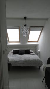 Een bed of bedden in een kamer bij B&B Bij Bijnen