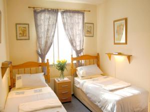 Кровать или кровати в номере St. George's Lodge