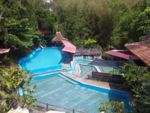 A view of the pool at Citra Homestay or nearby