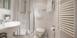 Ein Badezimmer in der Unterkunft Hotel Hangelar