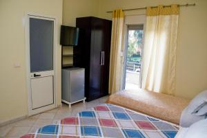 A television and/or entertainment center at Hotel 4 Stinet