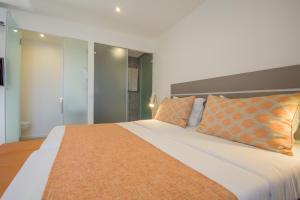 Een bed of bedden in een kamer bij Oasis Belorizonte