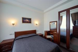 Кровать или кровати в номере Бизнес Отель