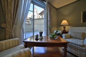 Area soggiorno di Appia Hotel Residences