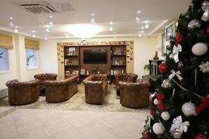 El salón o zona de bar de Hotel Starosadskiy