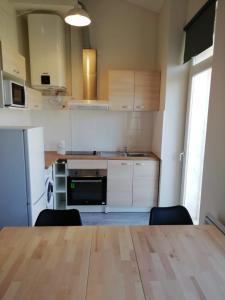 A kitchen or kitchenette at Boulevard de la Thèse Marseille