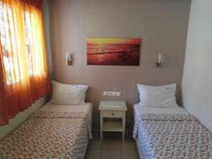 Ένα ή περισσότερα κρεβάτια σε δωμάτιο στο Haris Hotel Apartments and Suites