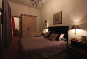 A bed or beds in a room at Les Buis