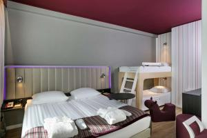 A bunk bed or bunk beds in a room at Park Inn by Radisson Central Tallinn