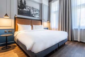 Postel nebo postele na pokoji v ubytování Radisson Blu Hotel Prague