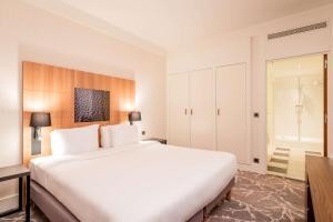 Кровать или кровати в номере Radisson Blu Hotel Paris, Marne-la-Vallée