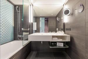 Salle de bains dans l'établissement Radisson Blu Hotel, Lucerne