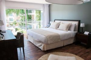 A bed or beds in a room at Radisson Colonia Del Sacramento Hotel