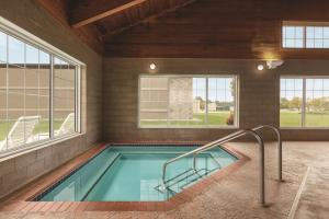 The swimming pool at or near Country Inn & Suites by Radisson, Willmar, MN