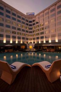 The swimming pool at or near Radisson Blu Hotel Ranchi