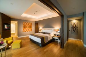 A bed or beds in a room at Radisson Blu Hotel, Kayseri