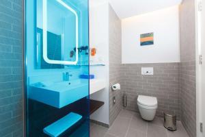 Ванная комната в Park Inn by Radisson Novokuznetsk