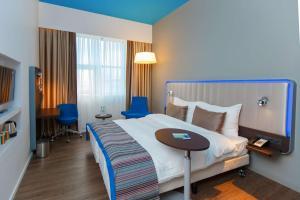 Кровать или кровати в номере Park Inn by Radisson Novokuznetsk