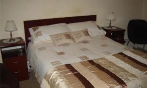 A bed or beds in a room at White House View Guest House
