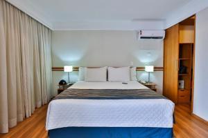 Cama ou camas em um quarto em eSuites Sorocaba by Atlantica