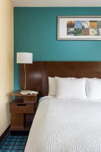 A bed or beds in a room at Fairfield Inn & Suites Lansing West