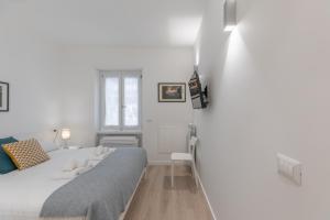 Letto o letti in una camera di Pigneto Delightful Apartment