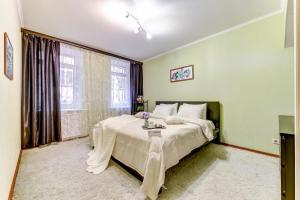Кровать или кровати в номере Апартаменты Веста на Фонтанке