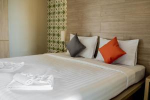 A bed or beds in a room at Chinotel - SHA Plus