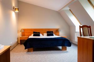 Łóżko lub łóżka w pokoju w obiekcie Hotel U Braci Zygmuntów