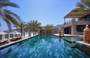 The swimming pool at or near Six Senses Zighy Bay