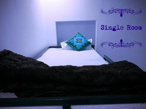 A bed or beds in a room at Tofu Hotel & Safari