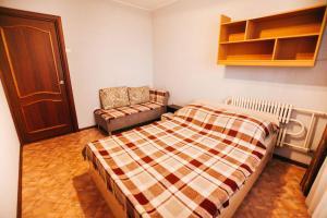 Кровать или кровати в номере Рылеева 96