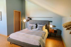Uma cama ou camas num quarto em Guest house Eça Agora!